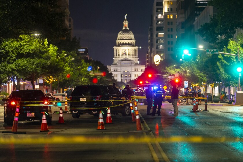 Austin police gather to investigate a homicide shooting