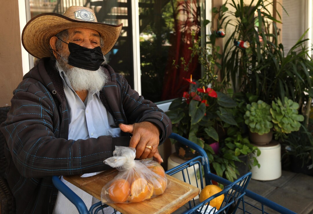 Ricardo Brito Miranda, 84, sits in front of his Oak View apartment, where he has lived for 40 years.
