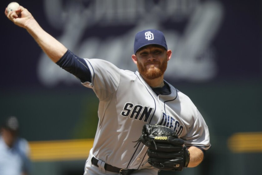 San Diego Padres starting pitcher Ian Kennedy works against the Colorado Rockies in the first inning of a baseball game Sunday, Aug. 16, 2015, in Denver. (AP Photo/David Zalubowski)