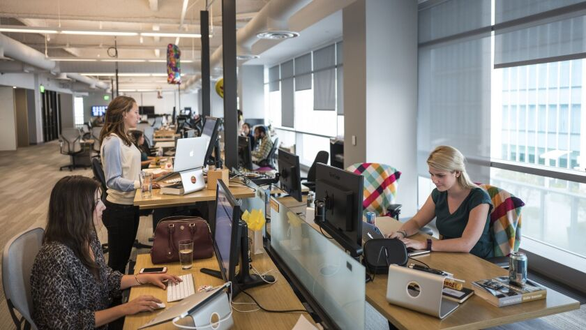 Employees work at Slack's San Francisco offices in 2015.