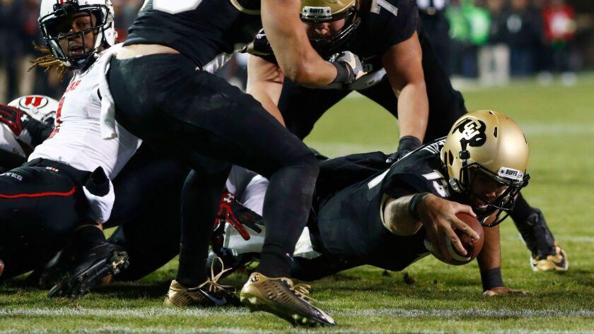 Colorado quarterback Sefo Liufau reaches across the goal line to score a touchdown against Utah on Nov. 26.