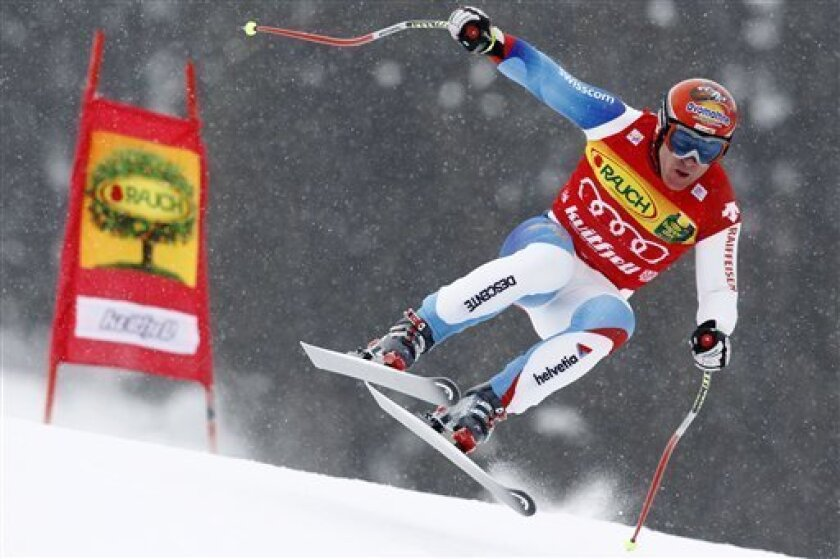 Didier Cuche of Switzerland is airborne on his way to set the fastest time during training for an alpine ski, Men's World Cup downhill, in Kvitfjell, Norway, Friday, March 5, 2010. (AP Photo/Cornelius Poppe, Scanpix)