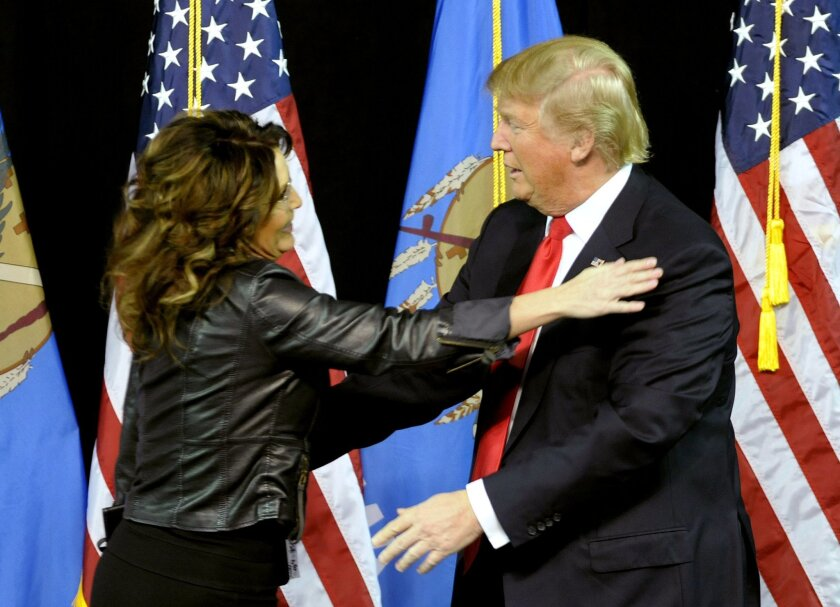 Former Republican vice presidential candidate Sarah Palin and hugs Republican presidential candidate Donald Trump after she introduced him in Tulsa, Okla., Wednesday, Jan 20, 2016. (AP Photo/Brandi Simons)
