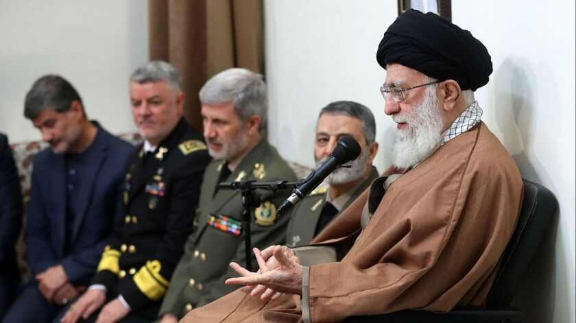Iranian supreme leader Ayatollah Ali Khamenei, right, speaking during a meeting with a group of Iranian Navy commanders in Tehran,