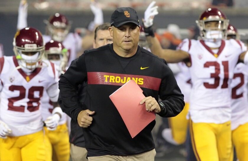 Another former Texas coach is joining Clay Helton's coaching staff at USC.