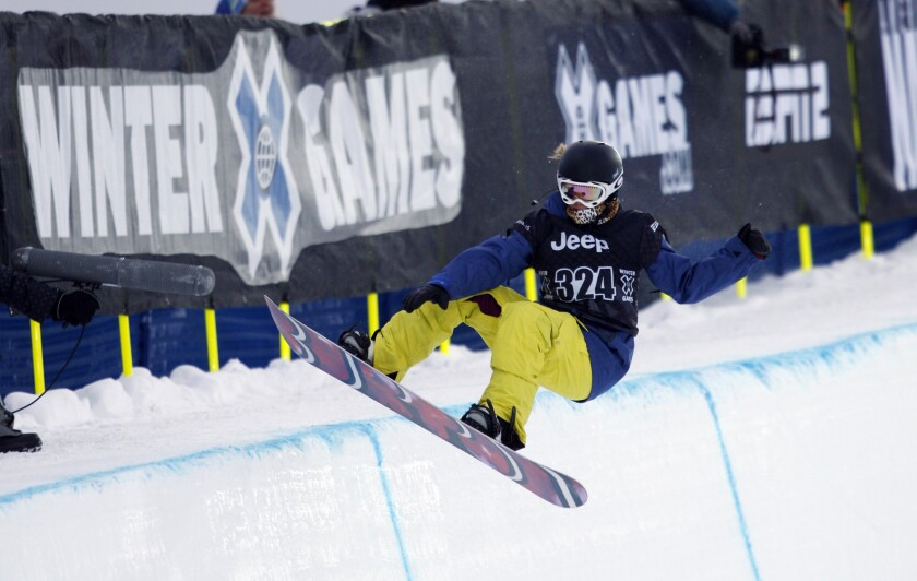 FILE - Elena Hight of South Lake Tahoe, Calif., competes during the snowboard superpipe women's elimination round during the Winter X Games at Buttermilk Mountain outside Aspen, Colo., in this Thursday, Jan. 28, 2010, file photo. The 2021 version of the Winter X Games promises lots of flipping and spinning, not so much singing and dancing. ESPN announced Tuesday, Dec. 15, 2020, that the first major action-sports contest since the COVID pandemic started forcing major cancellations will take place during its usual slot in Aspen during the last weekend of January, the 29th-31st, but will be closed off to fans. (AP Photo/David Zalubowski, File)