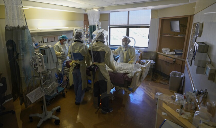A Covid-19 patient is flipped by  nurses and staff at Sharp Memorial Chula Vista Intensive Care Unit this week.