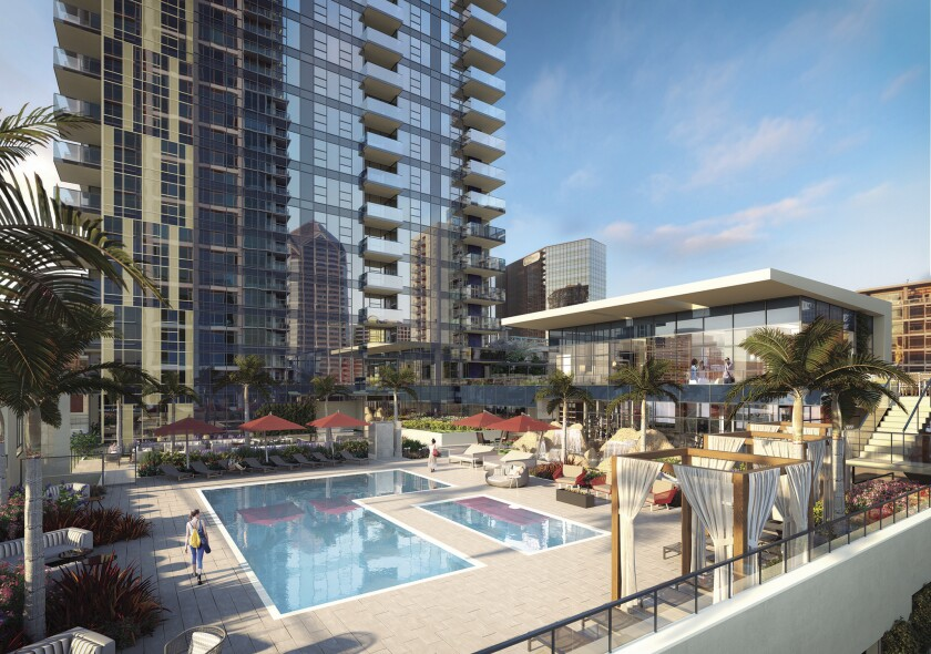 A lushly appointed deck area — complete with cabanas — surrounds the pool at Savina, a brand-new amenity-rich high-rise condo residence in downtown San Diego.