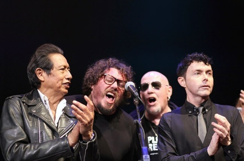 From left: Alejandro Escovedo, Bobby Bare Jr., Cheetah Chrome and Richard Barone celebrate Lou Reed at the Paramount Theatre in Austin, Texas, on Friday night during the South by Southwest festival.