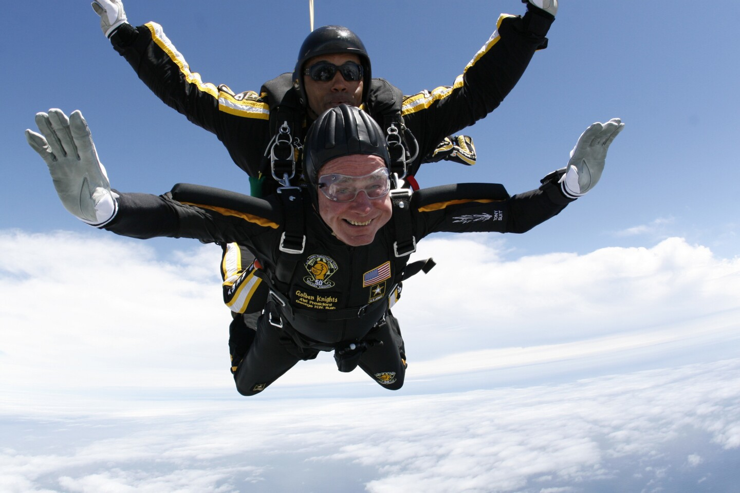 George H.W. Bush celebrates his 85th birthday with a parachute jump over Kennebunkport, Maine.