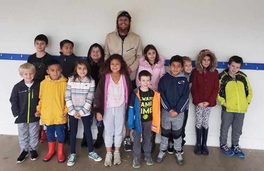 Brady Silverwood meets with Ramona Elementary's Running Club