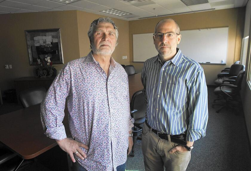 UCI is becoming the institutional home for the National Registry of Exonerations. Maurice Possley, left, and Simon Cole will run the registry.