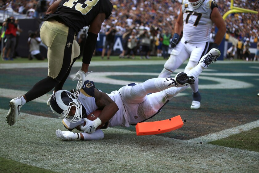 Rams running back Todd Gurley scores a touchdown during the third quarter of Sunday's win over the Saints.