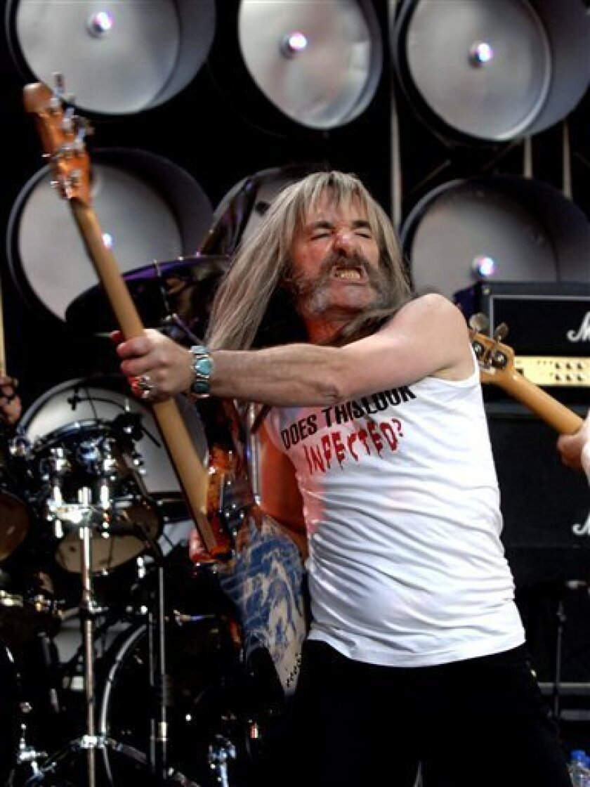 In this July 7, 2007 file photo, Henry Shearer of Spoof British band Spinal Tap performs on stage during the British leg of the Live Earth concerts at London's Wembley Stadium. (AP Photo/Anthony Harvey, file)