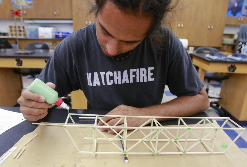 Vista High student David Maynes assembles a bridge through a personal learning program at the school, part of a districtwide effort to advance education technology.