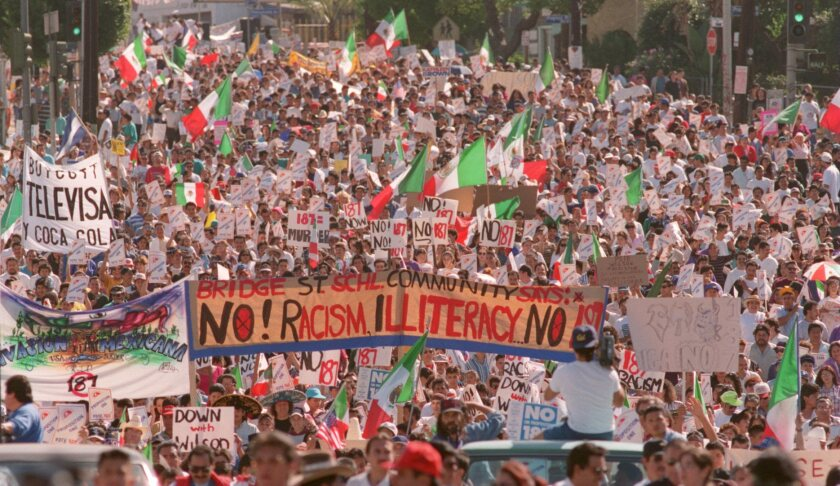 Protestors demonstrate against Proposition 187 in 1994