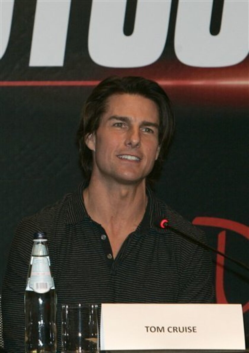 """The crew of the latest """"Mission Impossible"""" attend a press conference in Burj Khalifa Dubai, United Arab Emirates, Thursday Oct. 28, 2010. Filming includes shots involving the Burj Khalifa, the world's highest building. The cast, including star Tom Cruise, pictured, is in Dubai to shoot scenes for the film, which is due out late next year.(AP Photo/Farhad Berahman)"""