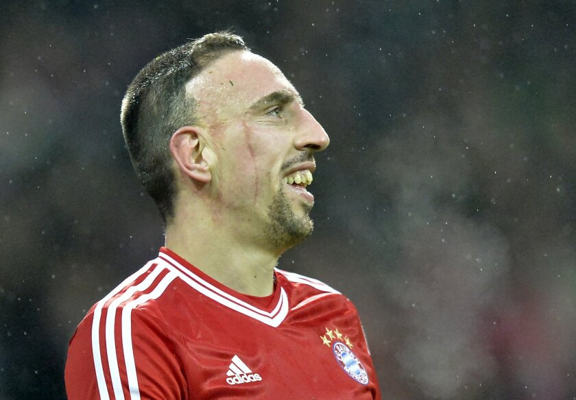 Bayern's thre- times scorer Franck Ribery of France smiles during the German Bundesliga soccer match between Werder Bremen and Bayern Munich in Bremen, Germany, Saturday, Dec. 7, 2013. Bayern defeated Bremen by 7-0. (AP Photo/Martin Meissner)