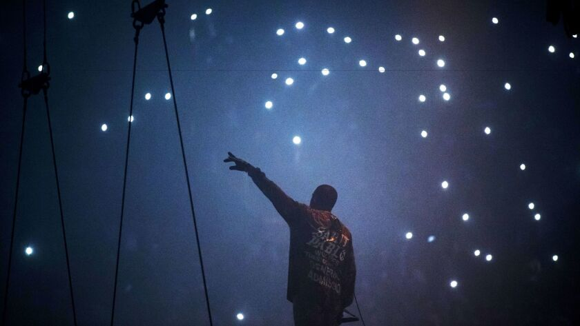 Kanye West performs at the Forum earlier this year.