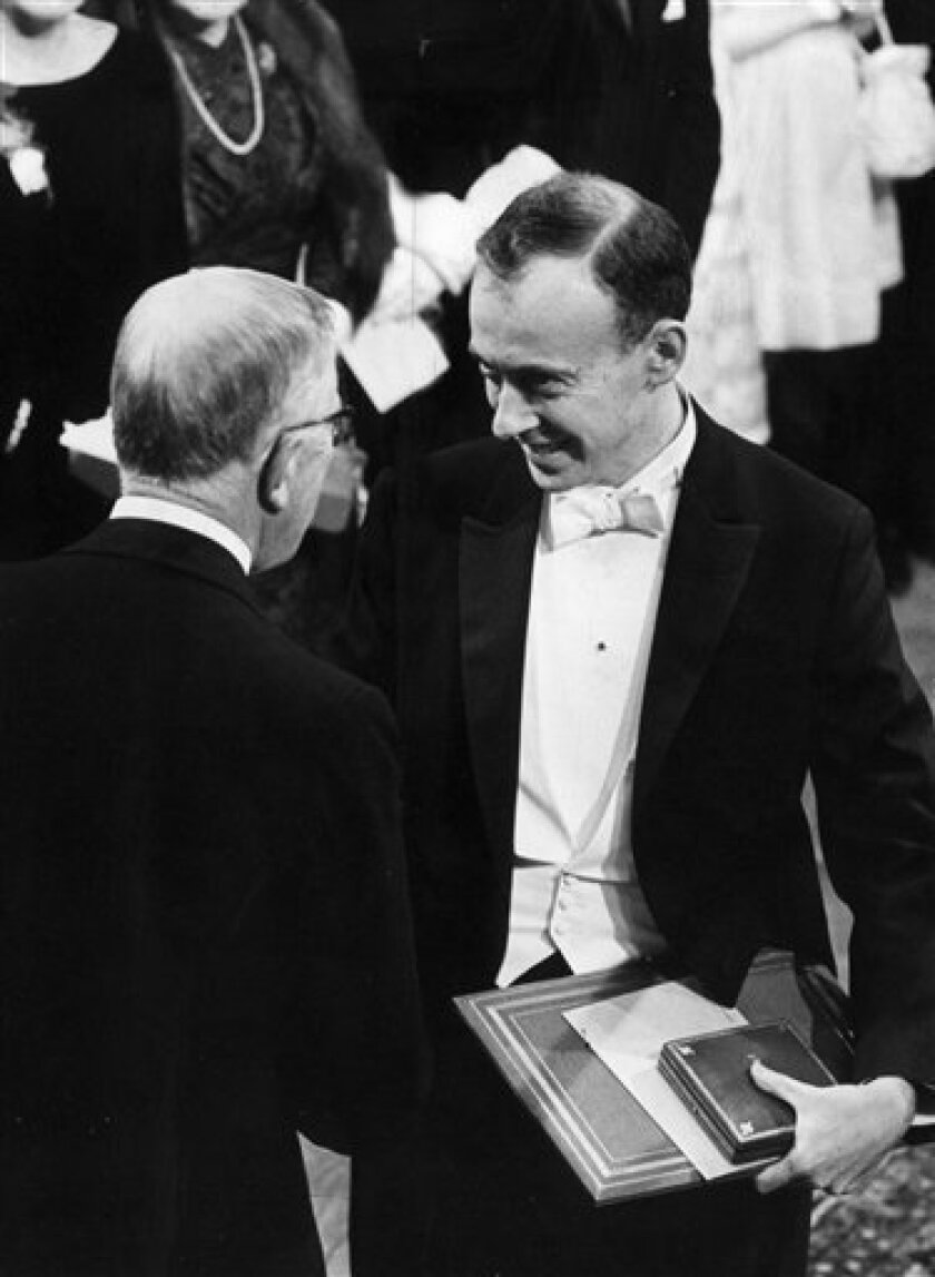 FILE In this Dec. 10, 1962 file photo, medicine laureate James Watson, right, receives his Nobel prize from Sweden's King Gustaf VI Adolf. Watson shared the prize with Francis Crick and Marurice Wilkins. Watson was the co-discoverer with Francis Crick of the DNA molecule structure. Famous Nobel winners include Albert Einstein, James Watson, Martin Luther King Jr., Nelson Mandela and Winston Churchill. But most winners are relatively anonymous until they suddenly are catapulted into the global spotlight by a phone call from a Nobel Prize juror with a Scandinavian accent. (AP photo/Scanpix Sweden/fls Pressens Bild)