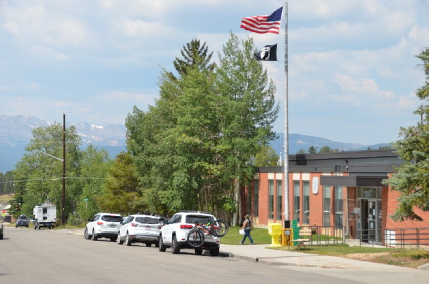 Snowy peaks, some exceeding 14,000 feet, loom above the post office in Leadville, Colo.