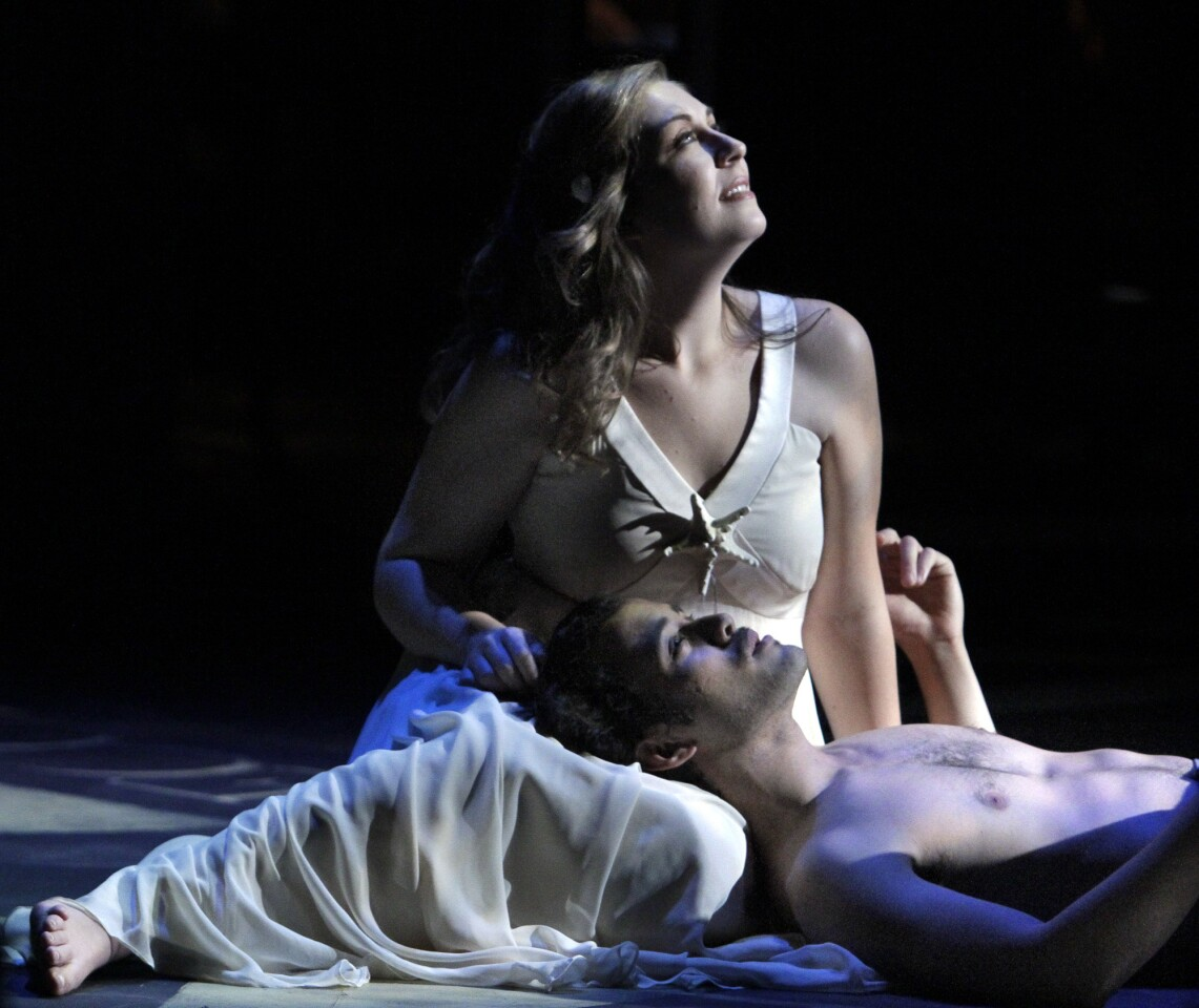 """Diana Newman portrays Miranda and David Castillo is Ferdinand in the dress rehearsal of """"The Tempest,"""" an opera by Lee Hoiby based on Shakespeare's work, at USC."""