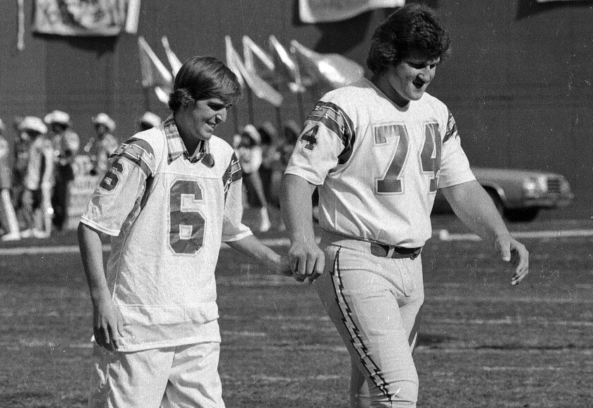 Chargers kicker Rolf Benirschke, who had been hospitalized, was escorted to midfield by Louie Kelcher for a game coin toss prior to a game against the Pittsburgh Steelers on Sept. 18, 1978.