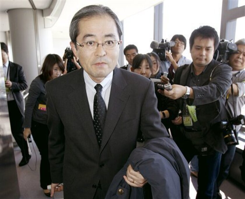 Japanese Ambassador to Russia Masaharu Kono arrives at Narita airport, near Tokyo Wednesday, Nov. 3, 2010. Japan temporarily recalled its ambassador from Moscow on Tuesday but left the door open for a possible summit despite growing anger in Tokyo over the Russian president's visit to a disputed island off Japan's northern coast. (AP Photo/Kyodo News)