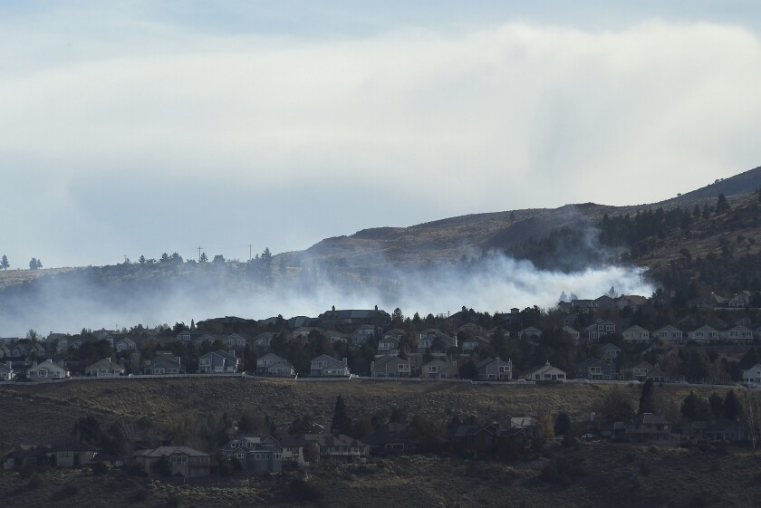 Fire burning in the Caughlin Ranch area of Reno on Tuesday