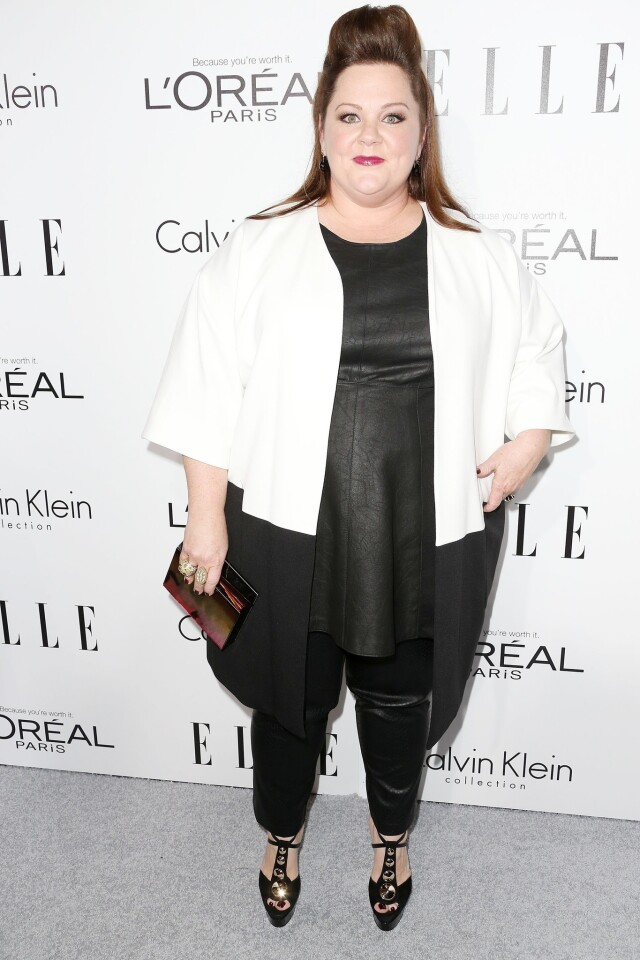 Actress Melissa McCarthy wore a Calvin Klein layered ensemble composed of a white and black jacket over a black leather tunic and fitted pants to Elle's 20th annual Women in Hollywood Celebration. Her outfit was edgy and anything but shapeless.