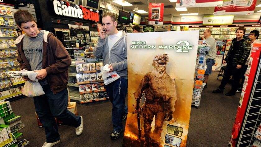 "Gamers get copies of ""Call of Duty: Modern Warfare 2"" at a GameStop store in Las Vegas in 2009."