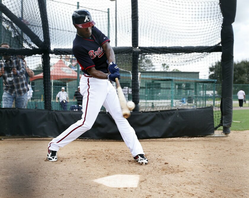 Atlanta Braves center fielder B.J. Upton hits a pitch during a spring training baseball workout, Monday, Feb. 24, 2014, in Kissimmee, Fla. (AP Photo/Alex Brandon)