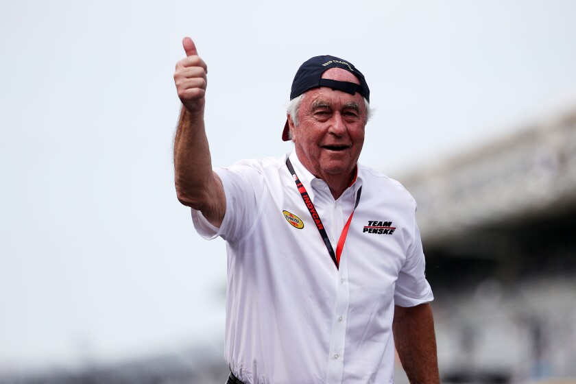 Team owner Roger Penske celebrates after his driver Simon Pagenaud wins the Indianapolis 500 on May 26 at Indianapolis Motor Speedway.