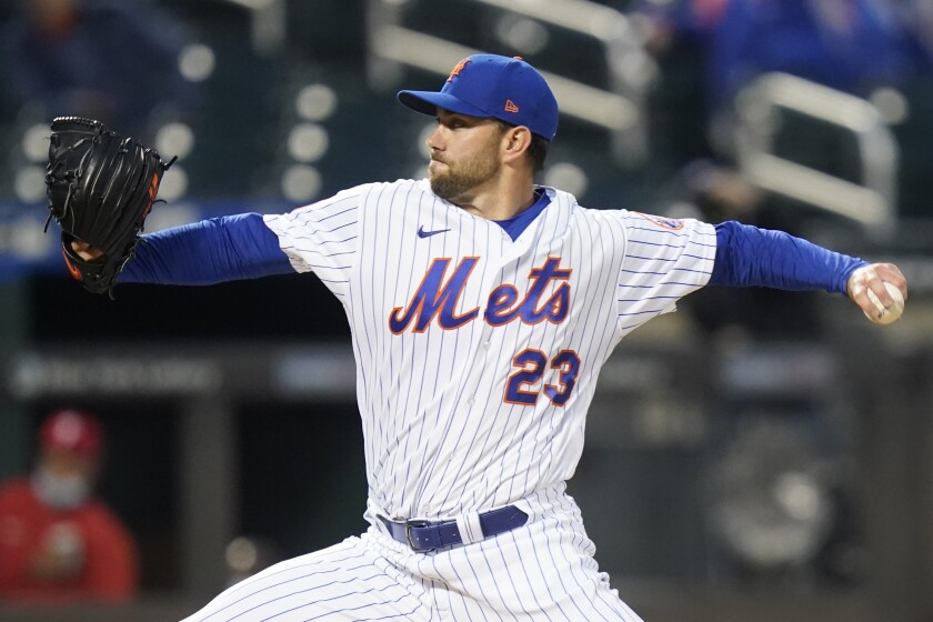 New York Mets' David Peterson (23) delivers a pitch during the first inning of a baseball game against the Philadelphia Phillies Wednesday, April 14, 2021, in New York. (AP Photo/Frank Franklin II)