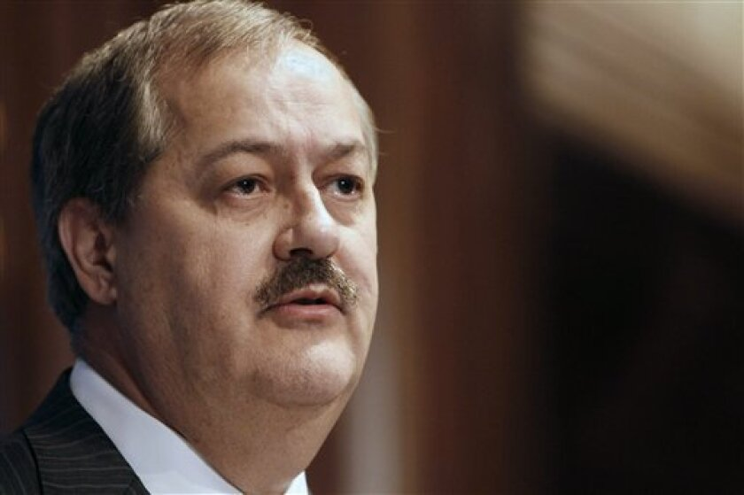 FILE -In this Thursday, July 22, 2010 file photo, Chairman and Chief Executive Officer of Massey Energy Company Don Blankenship speaks at the National Press Club in Washington. David Hughart, a former president of a Massey Energy subsidiary implicated the company's chief executive officer in safety