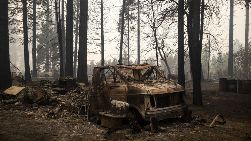 The remains of a vehicle at the campgrounds near Concow Reservoir after the Camp fire swept through the area.