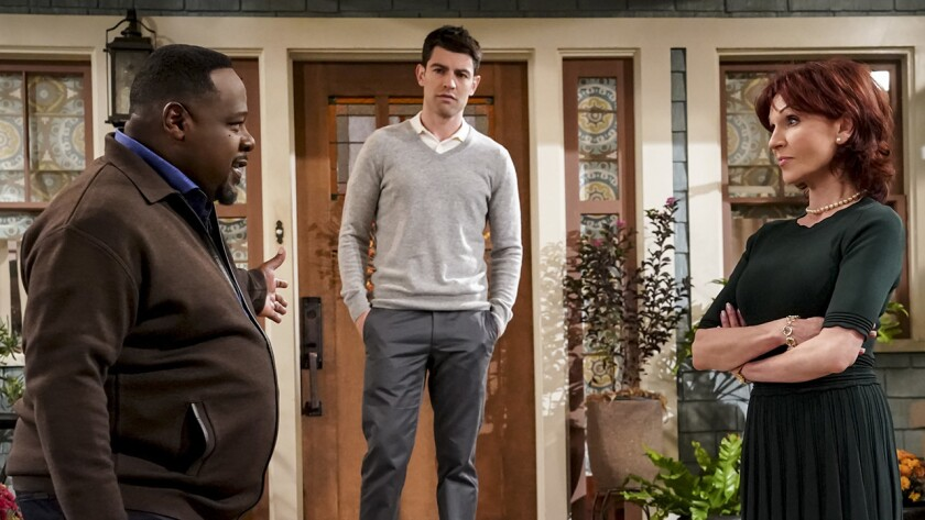 """Calvin (Cedric the Entertainer, left) meets Dave's (Max Greenfield) mother (Marilu Henner) in a Thanksgiving episode of the new comedy in """"The Neighborhod"""" on CBS."""