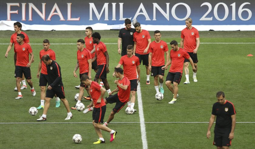 Atletico's players attend a training session at the San Siro stadium in Milan, Italy, Friday, May 27, 2016. The Champions League final soccer match between Real Madrid and Atletico Madrid will be held at the San Siro stadium on Saturday, May 28. (AP Photo/Antonio Calanni)