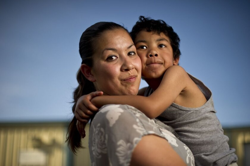 Crystal Nguyen, with her 6-year-old son, Neiko, in Pittsburg, Calif., is a former Valley State Prison for Women inmate. She worked in the prison's infirmary in 2007 and says she often overheard medical staff asking inmates who had served multiple prison terms to agree to be sterilized.