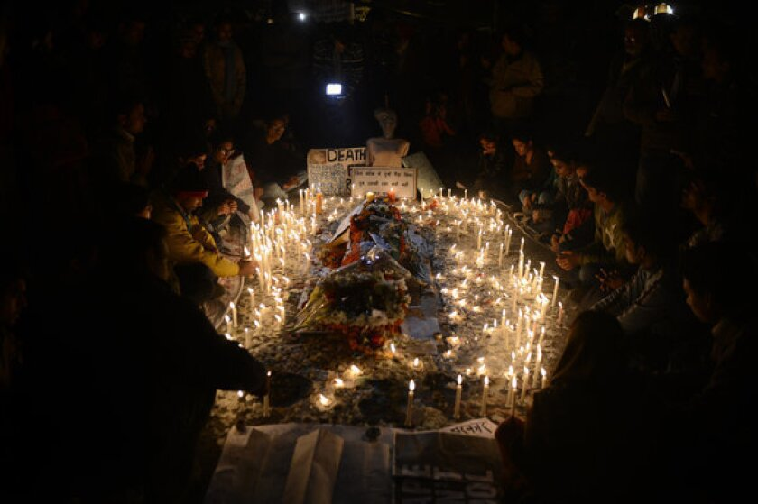 Indians gave up traditional New Year's Eve celebrations to attend candlelight vigils Monday night for the young medical student who died Saturday after a gang rape. Her plight has spurred widespread national soul-searching and calls for legal reform.