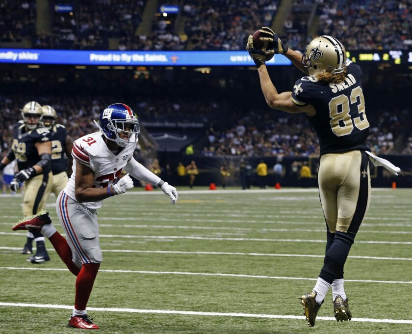 New Orleans Saints wide receiver Willie Snead (83) pulls in a touchdown pass in front of New York Giants defensive back Trevin Wade (31) in the first half of an NFL football game in New Orleans, Sunday, Nov. 1, 2015. (AP Photo/Jonathan Bachman)