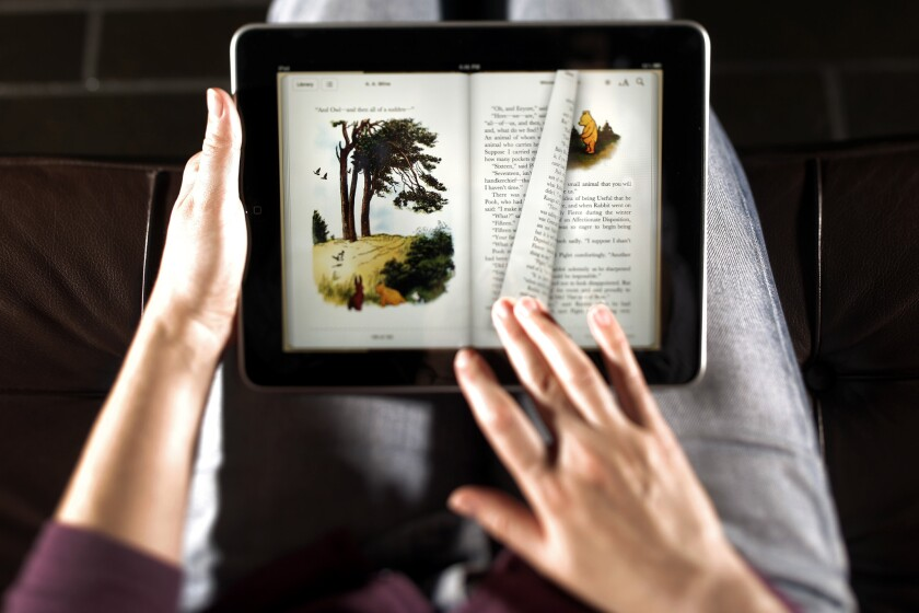 The turning of pages is demonstrated on the Apple iPad, which launched in 2010 with an emphasis on its e-book collection.