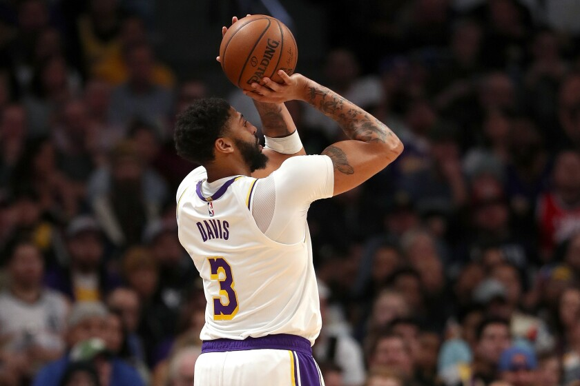 Lakers' Anthony Davis puts up a shot against the Denver Nuggets in the third quarter on Tuesday in Denver.
