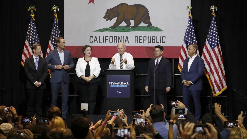 FULLERTON, CALIF. - OCT. 4, 2018. Former Vice President Joe Biden, center, sspeaks at a politcal r