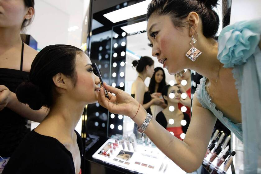 BB creams originally gained popularity in Asia, where whiter skin is especially prized. Here, Miss Asia Pageant contestants apply makeup during a promotional event at a Beijing department store.