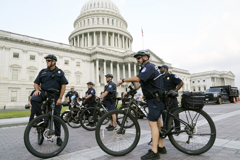U.S. Capitol Police officers on bicycles in front of the Capitol