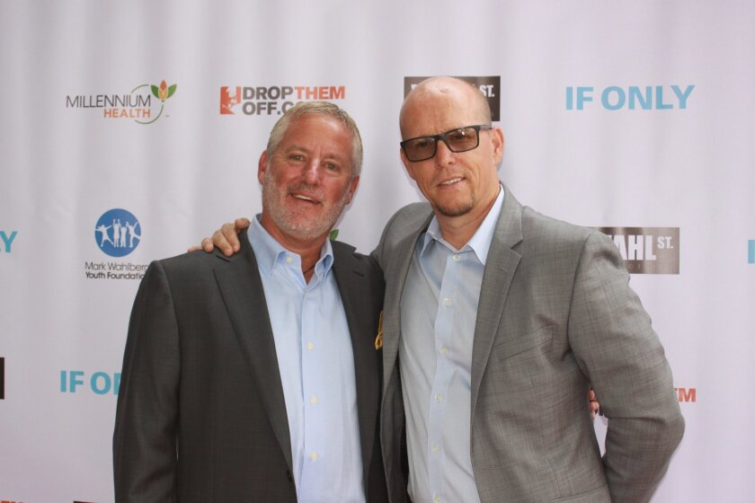 Howard Appel, president of Millennium Health with James Wahlberg, executive director of the Mark Wahlberg Youth Foundation.