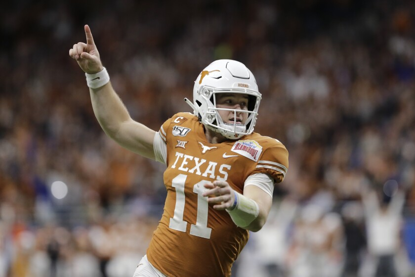 FILE - Texas quarterback Sam Ehlinger celebrates a touchdown against Utah during the first half of the Alamo Bowl NCAA college football game in San Antonio, Tuesday, Dec. 31, 2019. Ehlinger enters his fourth season as a starter and his 8,870 yards and 68 touchdowns both rank second in program career passing records. (AP Photo/Austin Gay, FIle)
