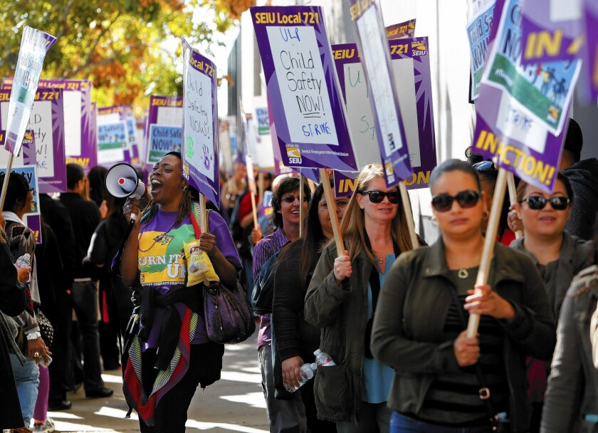 Los Angeles County child-welfare workers march outside the Department of Children and Family Services office in downtown L.A. during a six-day strike in December.