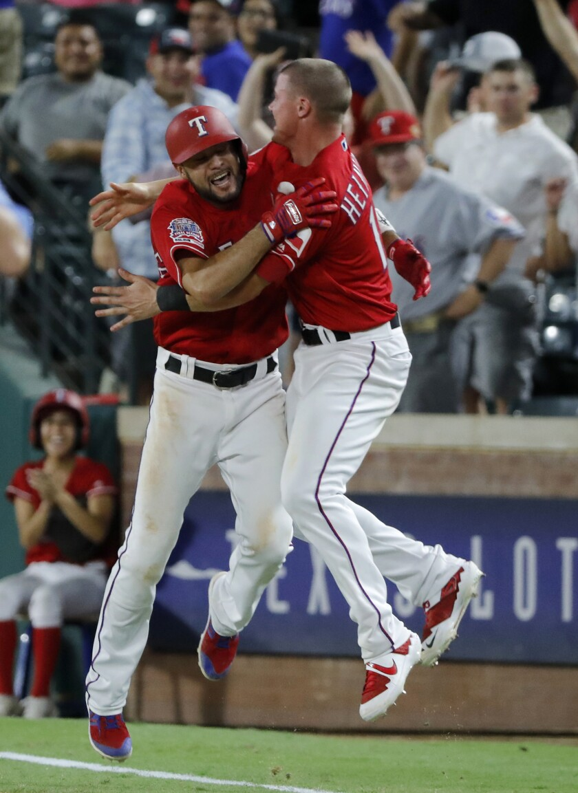 Isiah Kiner-Falefa, left, celebrates with Texas Rangers teammate Scott Heineman.